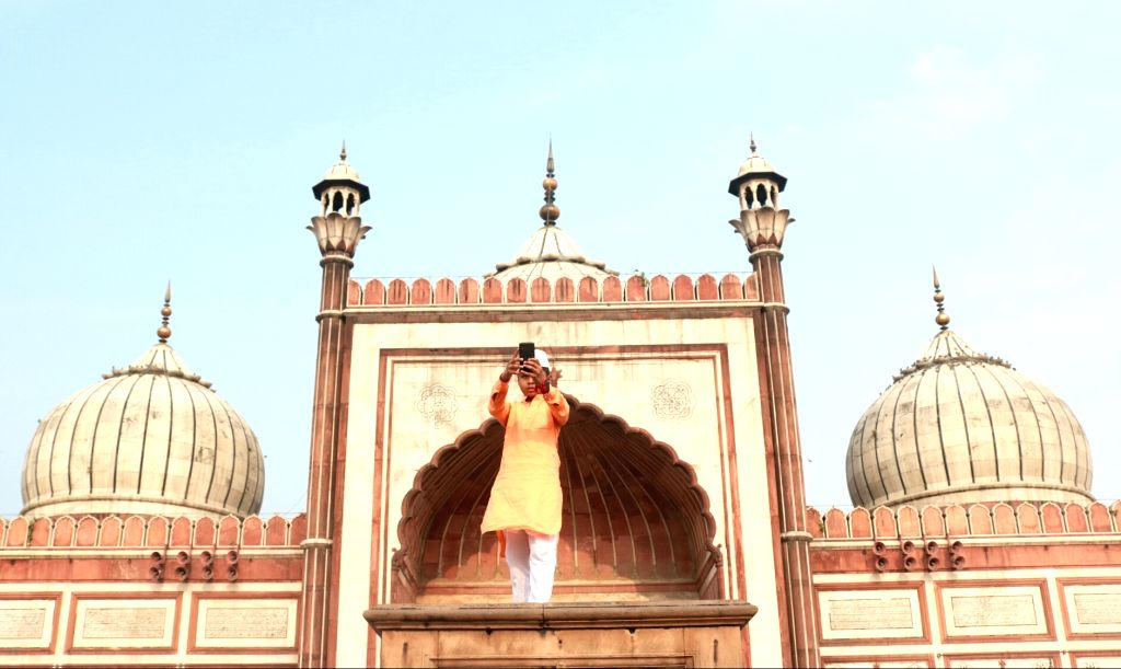 A Muslim boy taking pictures on the occasion of Eid-ul-Fitr, at Jama  Masjid in New Delhi on June 26, 2017.