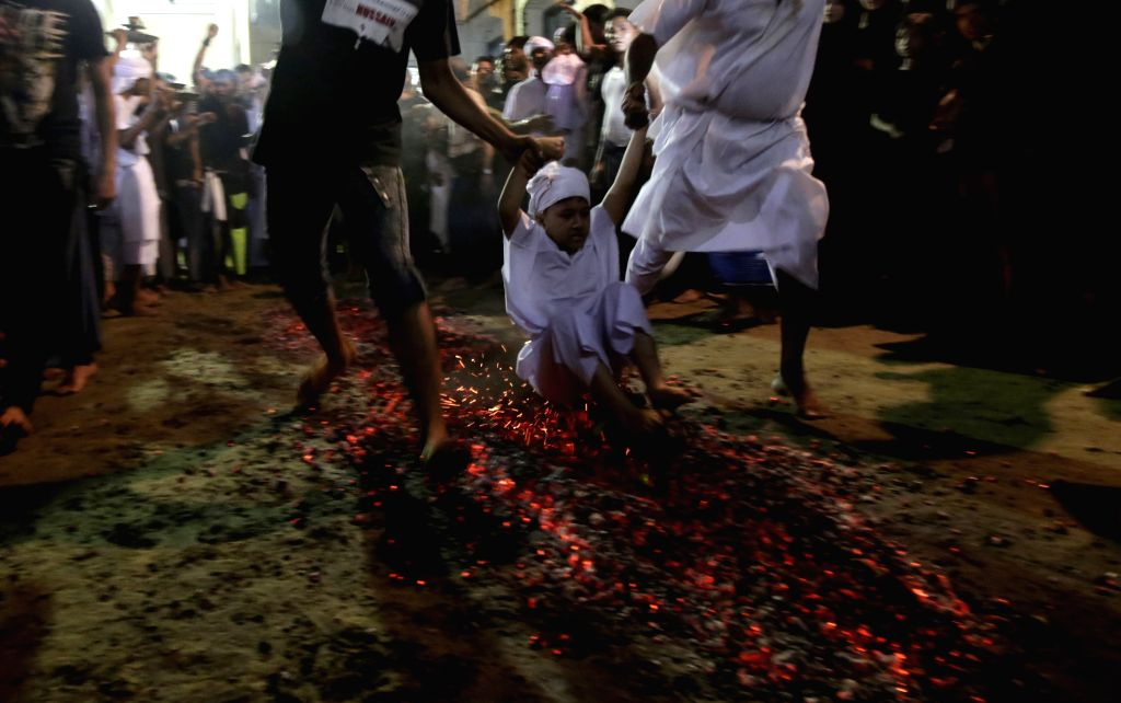 A Muslim child takes part in a ceremony ahead of the coming Ashura at a mosque in Yangon, Myanmar, Oct. 21, 2015. Ashura, the 10th day of the Islamic month of ...