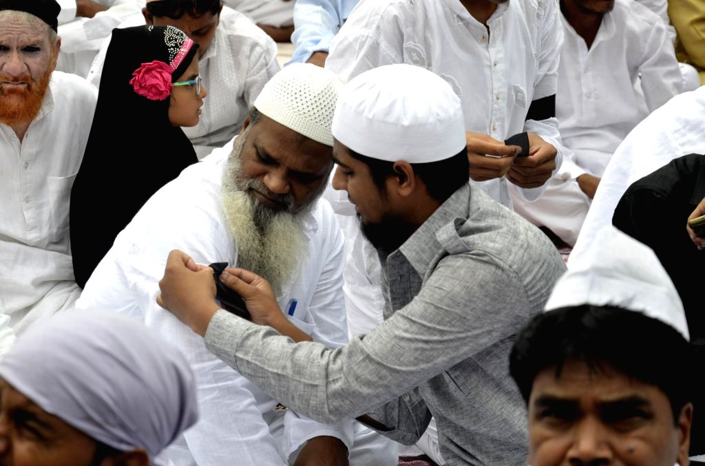 A muslim man tie a black ribbon to protest against the recent communal violence during Eid-ul-Fitr prayer in Ranchi, Jharkhand on June 26, 2017.