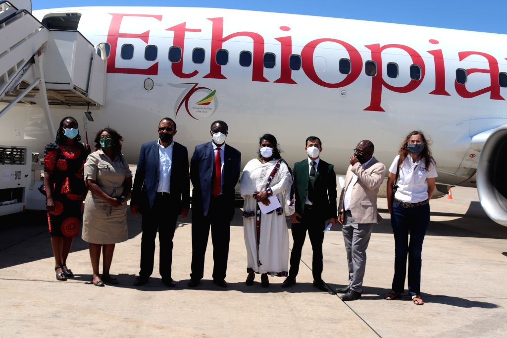 A Namibian delegation welcomes the pilot and crew of the Ethiopian Airlines flight that landed in Windhoek, Namibia, on Sept. 11, 2020. Namibia's flagship ...