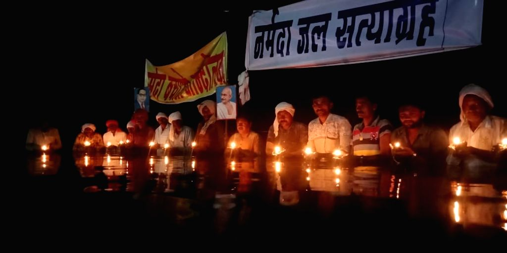 A Narmada Bachao Andolan (NBA) leader and nine displaced persons have launched 'jal satyagraha' in the Narmada river in Madhya Pradesh demanding that water level in the Omkareshwar dam be brought ...