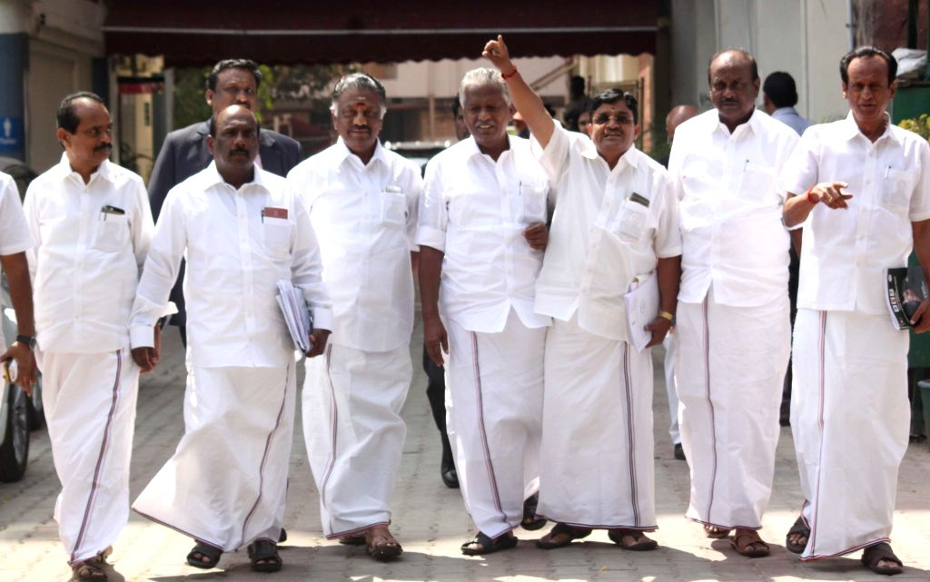 A nine-member delegation led by O Panneerselvam outside EC office after meeting Chief Election Commissioner Nazim Zaidi to stake claim for the AIADMK's two-leaves symbol; in New Delhi on ...