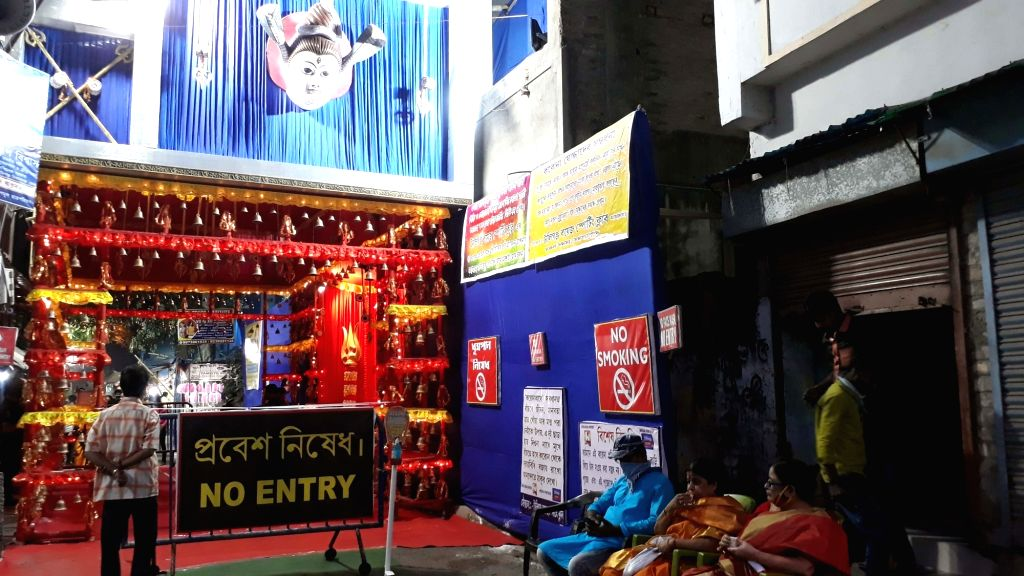 A 'No Entry' board put up outside a puja pandal during Kali Puja celebrations, in Kolkata on Nov 14, 2020.