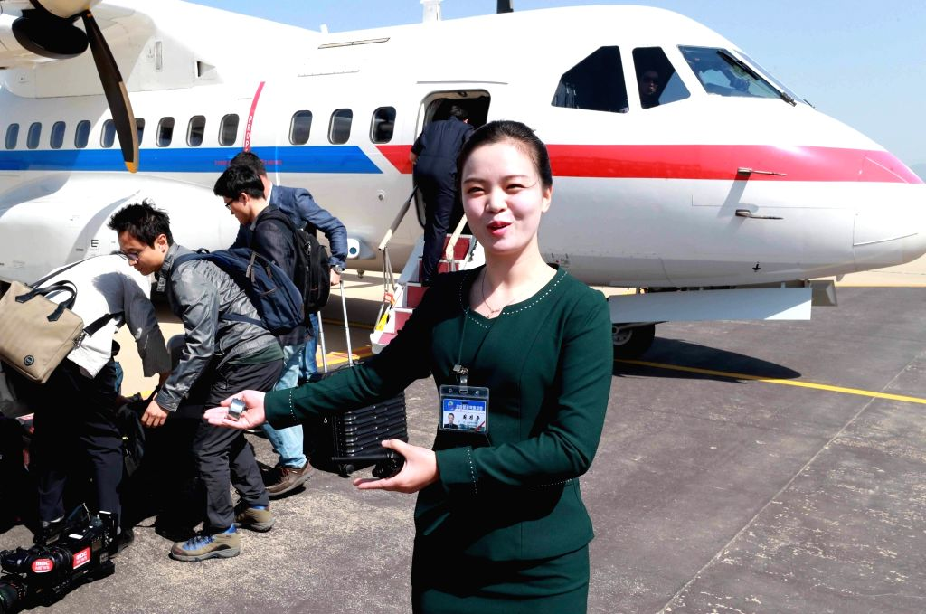 A North Korean woman guides South Korean reporters at an airport in North Korea's eastern port city of Wonsan on May 23, 2018, in this pool photo. They arrived there to cover the dismantlement ...