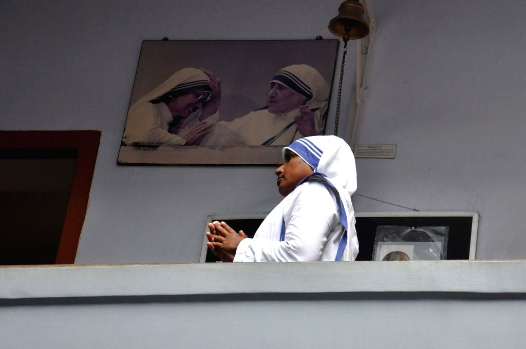 A nun pays tribute to Mother Teresa on her 104th birth anniversary at the Mother House in Kolkata on Aug 26, 2014.