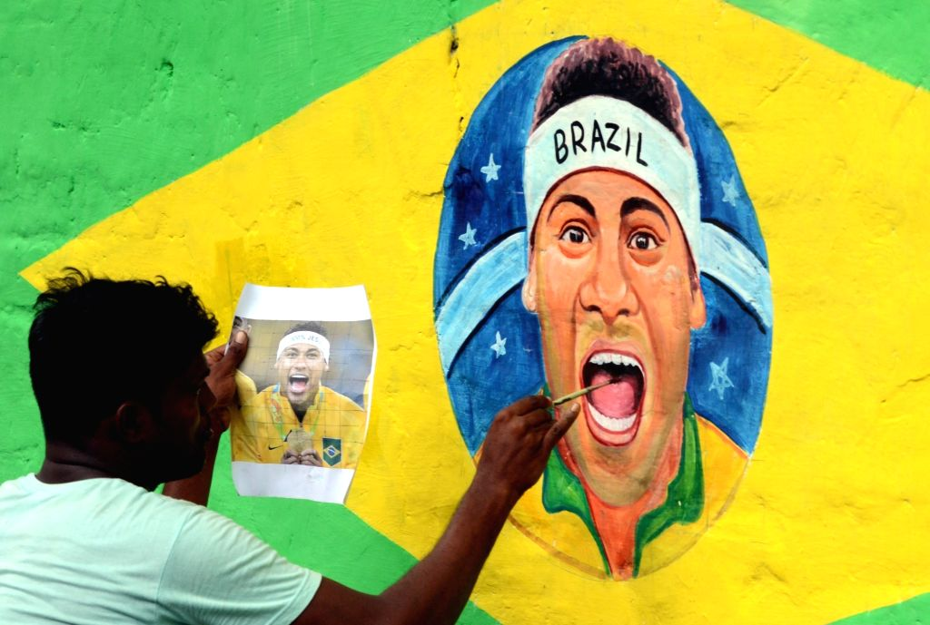 A painter paints a picture of Brazilian footballer Neymar da Silva Santos Junior ahead of FIFA 2018 that is scheduleto be held in Russia; in Kolkata, on June 4, 2018.