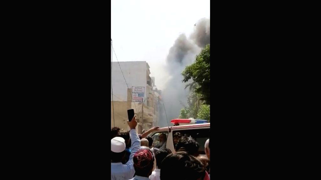 A Pakistan International Airlines (PIA) plane crashed in a residential area in Karachi near the city's Jinnah International Airport on Friday, an official of the flag carrier has confirmed. The crash took place in the city's Model Colony area. PIA sp - Colony