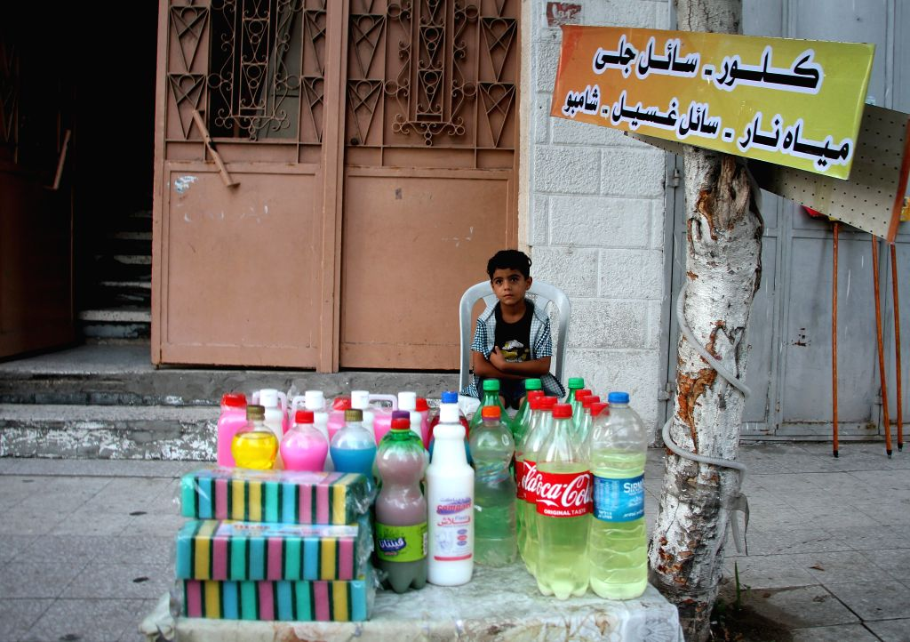 A Palestinian boy sells cleaning tools and disinfectants in Gaza City, Aug. 28, 2020. Palestine recorded two deaths and 724 new COVID-19 cases in the Palestinian ...