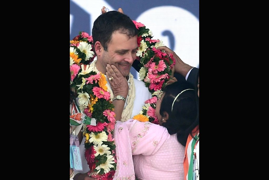 A Parsi woman garland Congress President Rahul Gandhi during a public meeting in Gujarat's Valsad district on Feb 14, 2019. - Rahul Gandhi