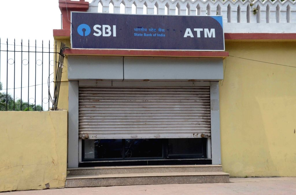 A partially closed State Bank of India ATM during the second day of the nationwide bank strike spearheaded by the United Forum of Bank Unions (UFBU), an umbrella body of nine unions; in Patna ...