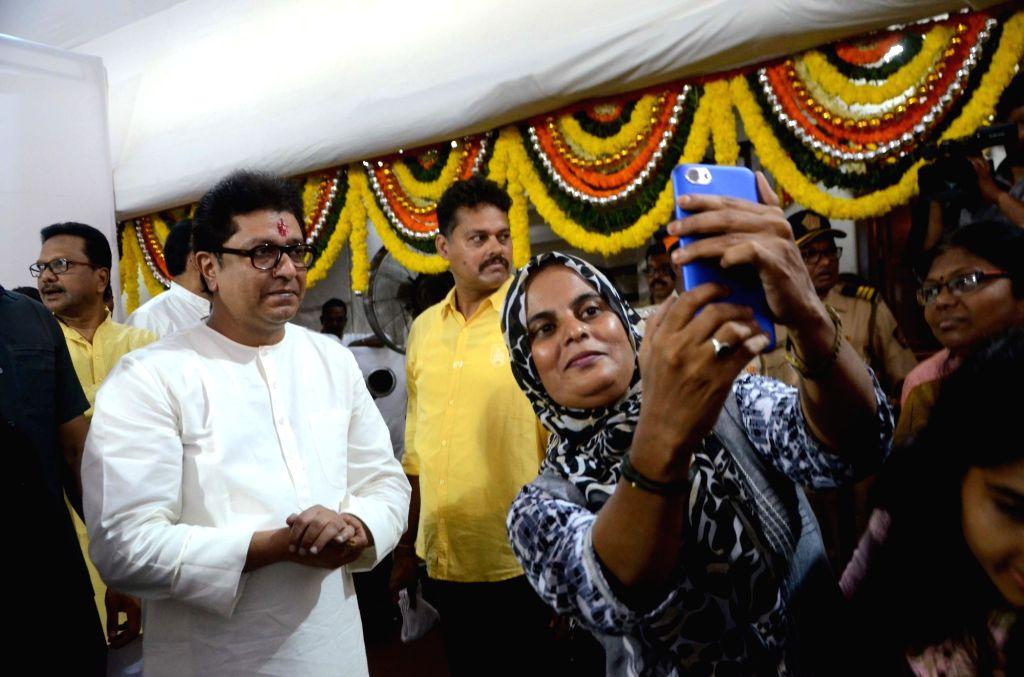A party worker clicks a selfie with Maharashtra Navnirman Sena (MNS) President Raj Thackeray during his birthday celebrations at his residence in Dadar, Mumbai on June 14, 2018.