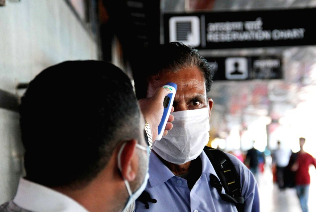 A passenger being screened for COVID-19 amid coronavirus pandemic, at the New Delhi Railway Station on March 18, 2020.