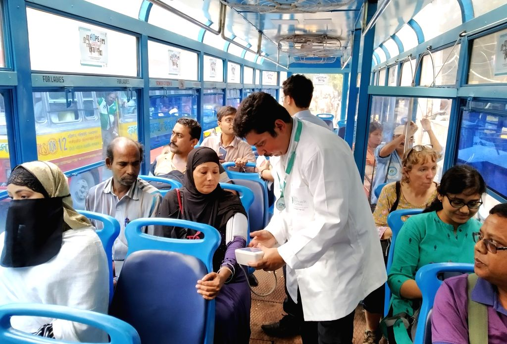 A passenger gets free check up during a health camp cum awareness programme on good health organised by DS Research Centre in Kolkata on Oct 25, 2019.