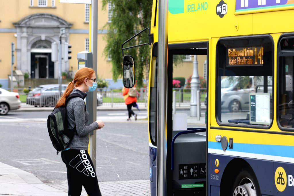 A passenger gets on a bus in Dublin, Ireland, on July 13, 2020. Wearing a mask or face covering on Ireland's public transport is a must starting from Monday or one ...
