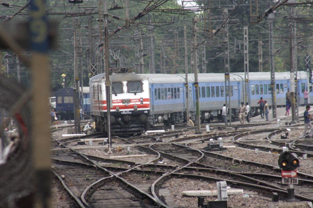 A passenger train leaves New Delhi railway station during a trial run of a 'semi-bullet train' between New Delhi and Agra  on July 3, 2014. The train reached Agra in 90 minutes, covering a distance ..