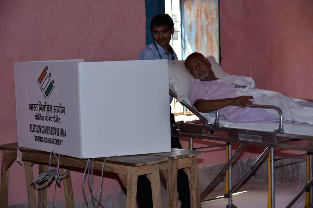 A patient, who arrived in an ambulance at a polling station to cast vote during the last phase of 2019 Lok Sabha polls, in patna, on May 19, 2019.