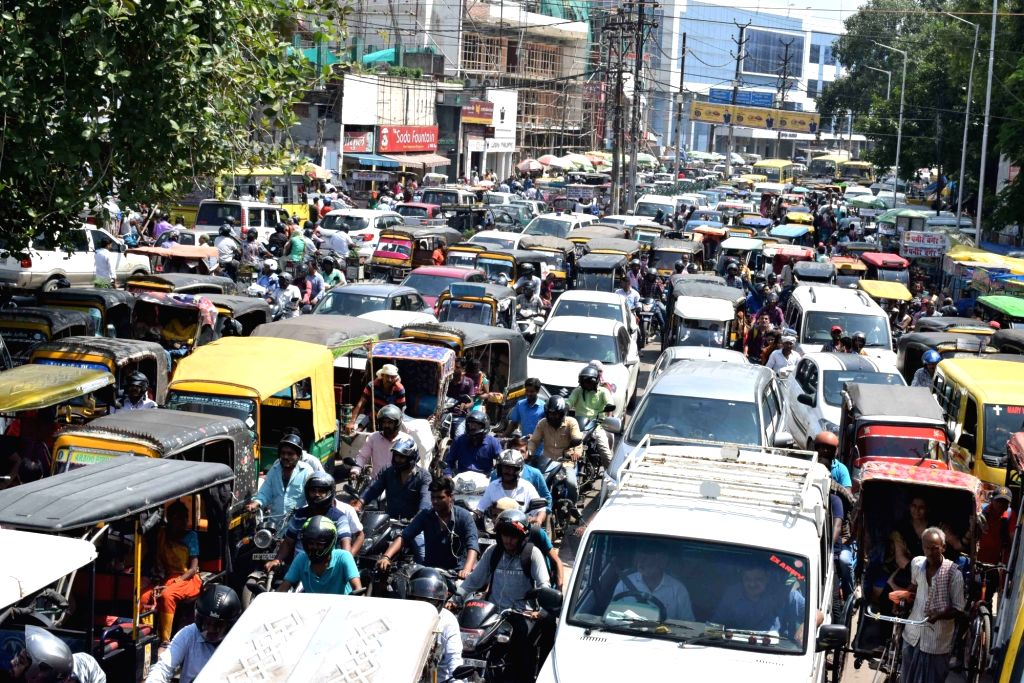 A Patna road witnesses massive traffic jam as Bihar constable aspirants blocked vehicular traffic while staging a demonstration to demand for a decrease in the height requirement to 155 cm, on ...