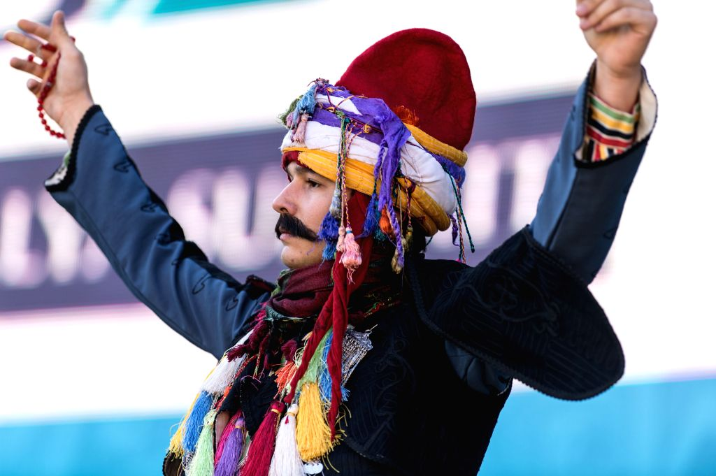 """A performer dances at the """"Home Culture"""" Zone of the site of G20 Summit, which will be held from Nov. 15 to 16, in Antalya, a Mediterranean resort city of ..."""