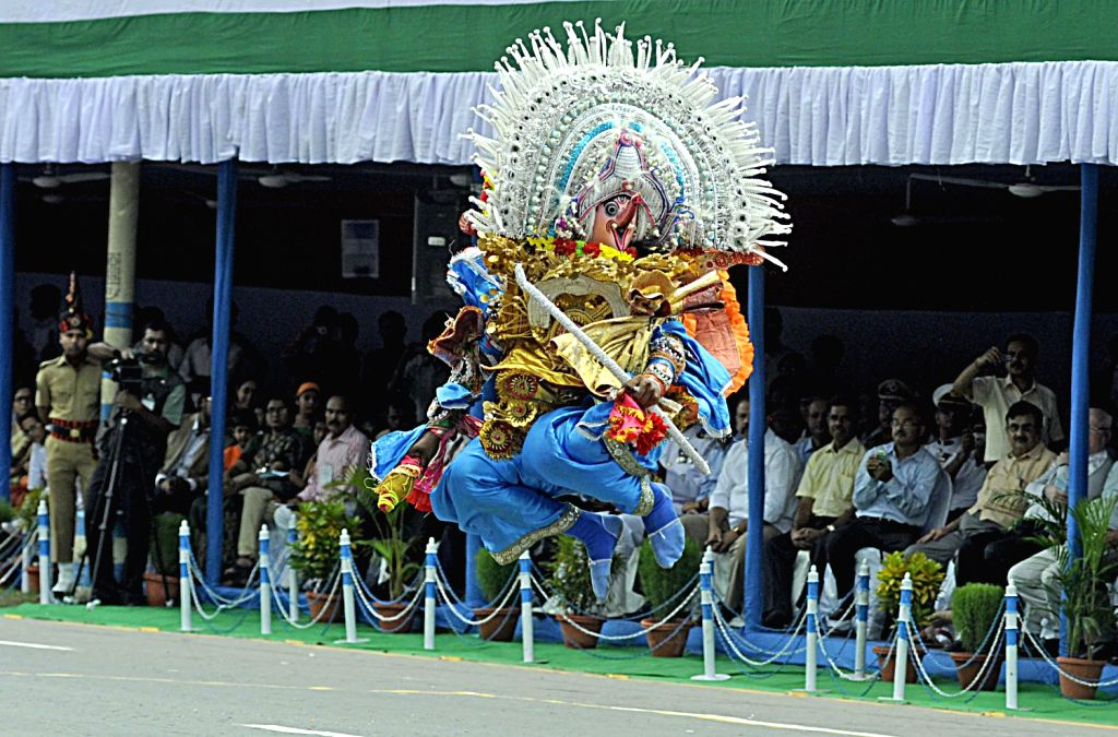 A performer performing traditional dance form called Chhau Nritya during 67th Independence day celebration in Kolkata on August 15, 2013. (Photo::: IANS)