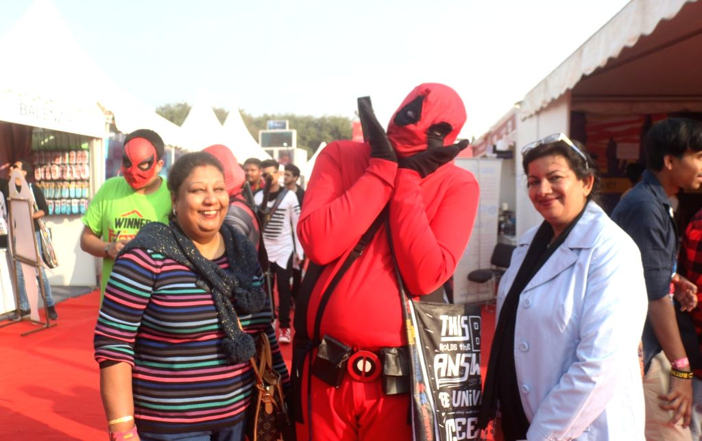 """A person dressed up as fictional character from American comic books """"Deadpool"""" at the three-day fest - """"Comic Con"""" in New Delhi on Dec 7, 2018."""