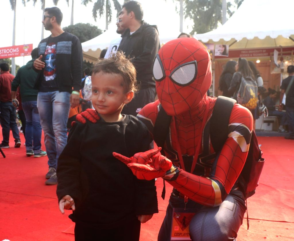"""A person dressed up as fictional superhero """"Spider-Man"""" at the three-day fest - """"Comic Con"""" in New Delhi on Dec 8, 2018."""
