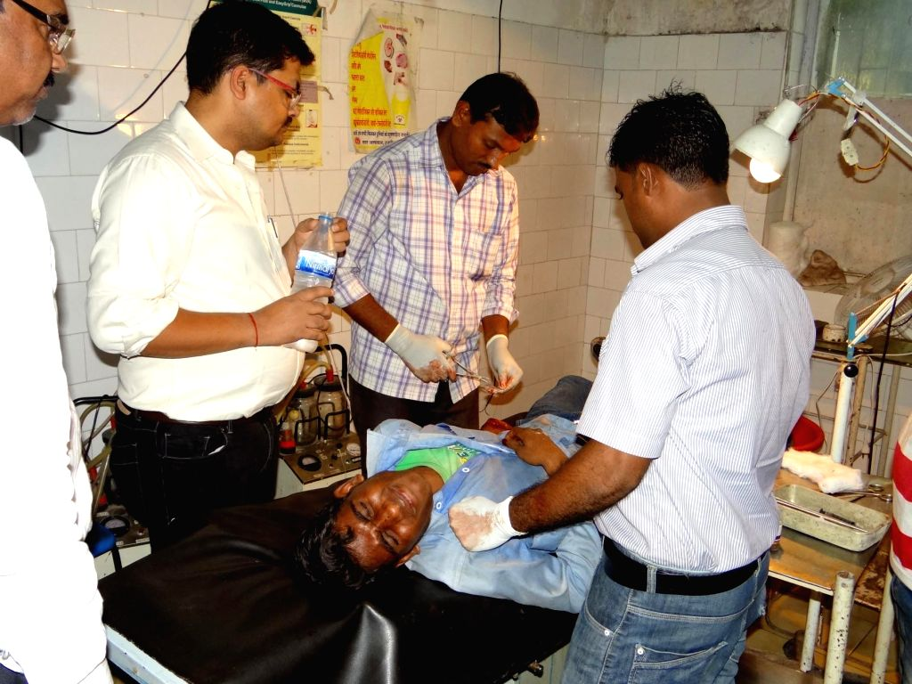 A person injured in a clash over compensation for land acquisition being treated in a hospital in Hazaribagh district of Jharkhand on Aug 14, 2015.