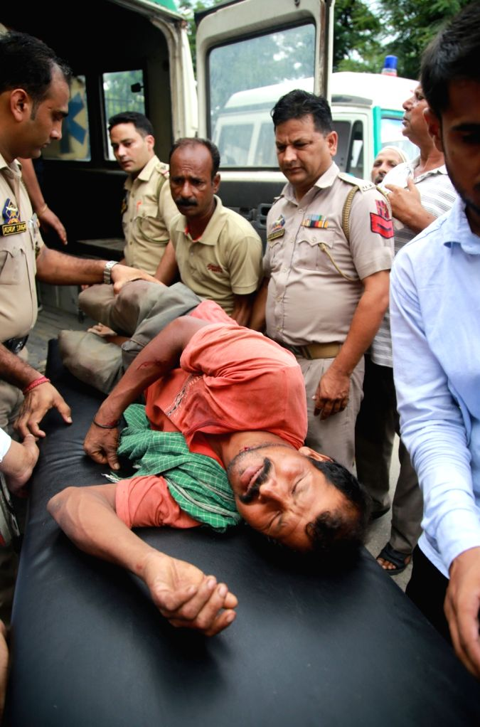 A person injured in a explosion being taken for treatment after labourer from Bihar was killed and five others were injured in an explosion in Arnia sub-sector of the international border ...