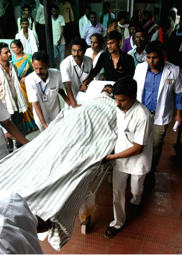 A person injured in a fire that broke out at Indian Army's ammunition depot in Maharashtra's Pulgaon being taken for treatment at Sawangi Meghe hospital in Wardha on May 31, 2016. At least 16 ...