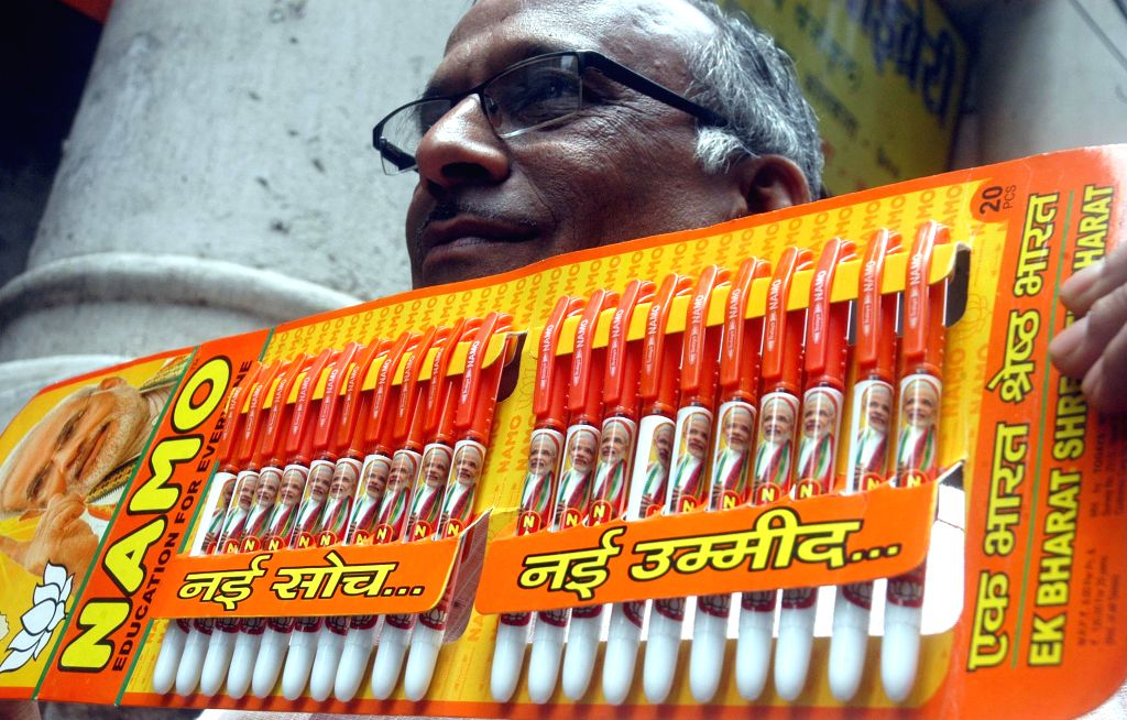 A person shows BJP Prime Ministerial candidate and Gujarat Chief Minister Narendra Modi branded pens in Kolkata on May 5, 2014.