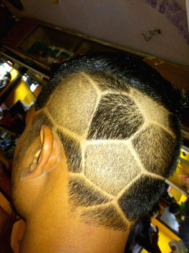 A person shows his new 'football haircut' in Bicholim of Goa on June 22, 2014.