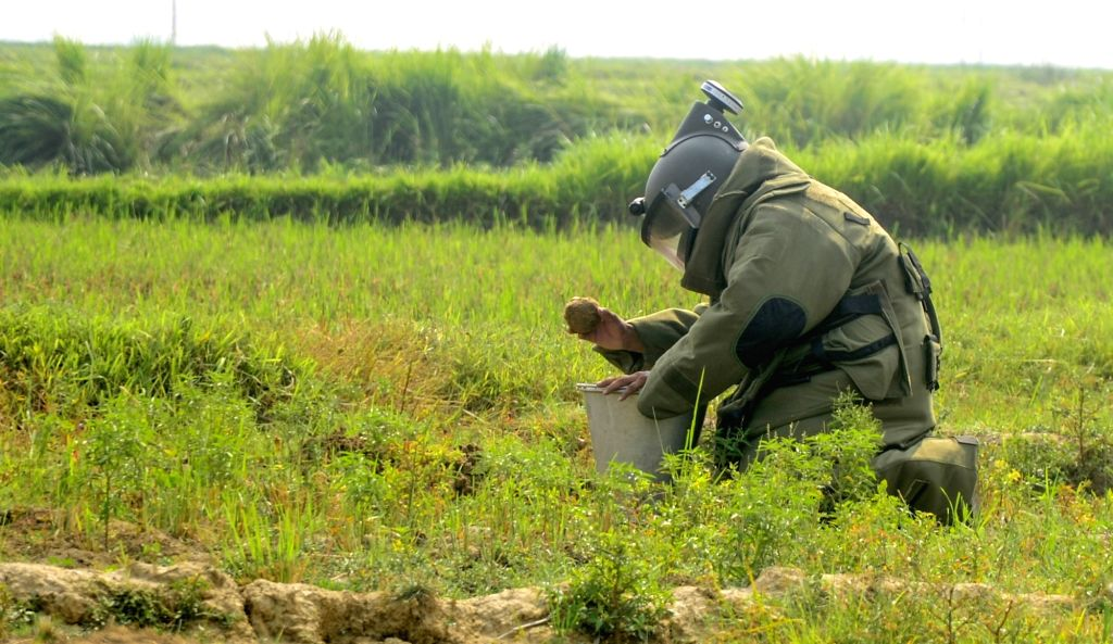 A personal from the Bomb Disposal Squad diffuses a crude bomb in Bandar village under Nanoor police station in Bolpur subdivision of Birbhum district in West Bengal, on June 13, 2019. The ...