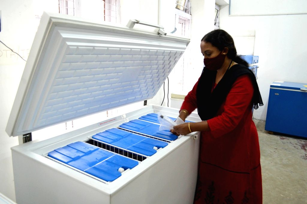 A pharmacy officer conducts routine checks of the Electronic Vaccine Intelligence Network (EVIN) cold storage equipment at N Dasappa Thirumalamma Maternity Hospital proposed by the ...