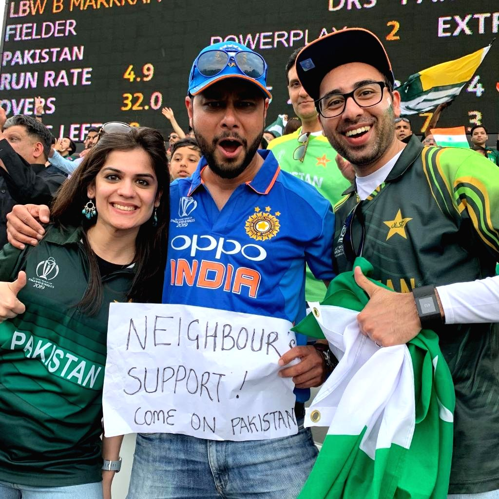 A photo of a man at Lord's wearing the Indian jersey but cheering for Pakistan went viral on social media. The man was seen holding a placard which read 'Neighbour's Support! Come On Pakistan'. (Photo: Twitter/@cricketworldcup)