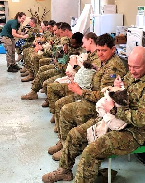 """A photo of Australian army soldiers feeding and cuddling rescued koalas is doing the rounds on the Internet. Many servicemen and women were captured taking care of the koalas, wrapped in blankets.The Australian Army shared the picture with caption, """""""
