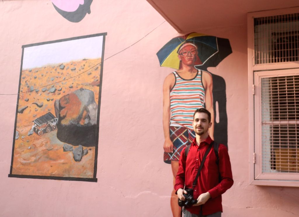 A photographer during the inauguration of street art project by the delegation of European union to India, on International Women's Day at Lodhi Art District, in New Delhi, on March 8, ...