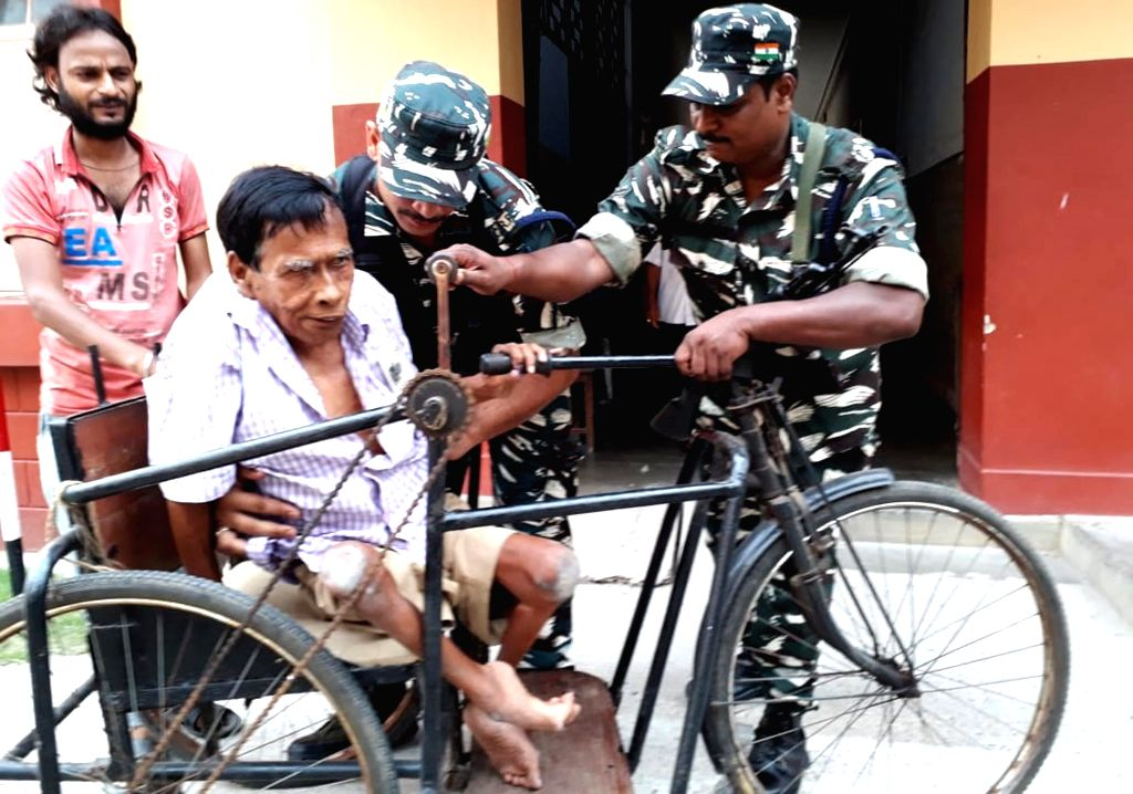 A physically challenged man, arrives at a polling station to cast vote during the last phase of 2019 Lok Sabha polls, in Kolkata, on May 19, 2019.