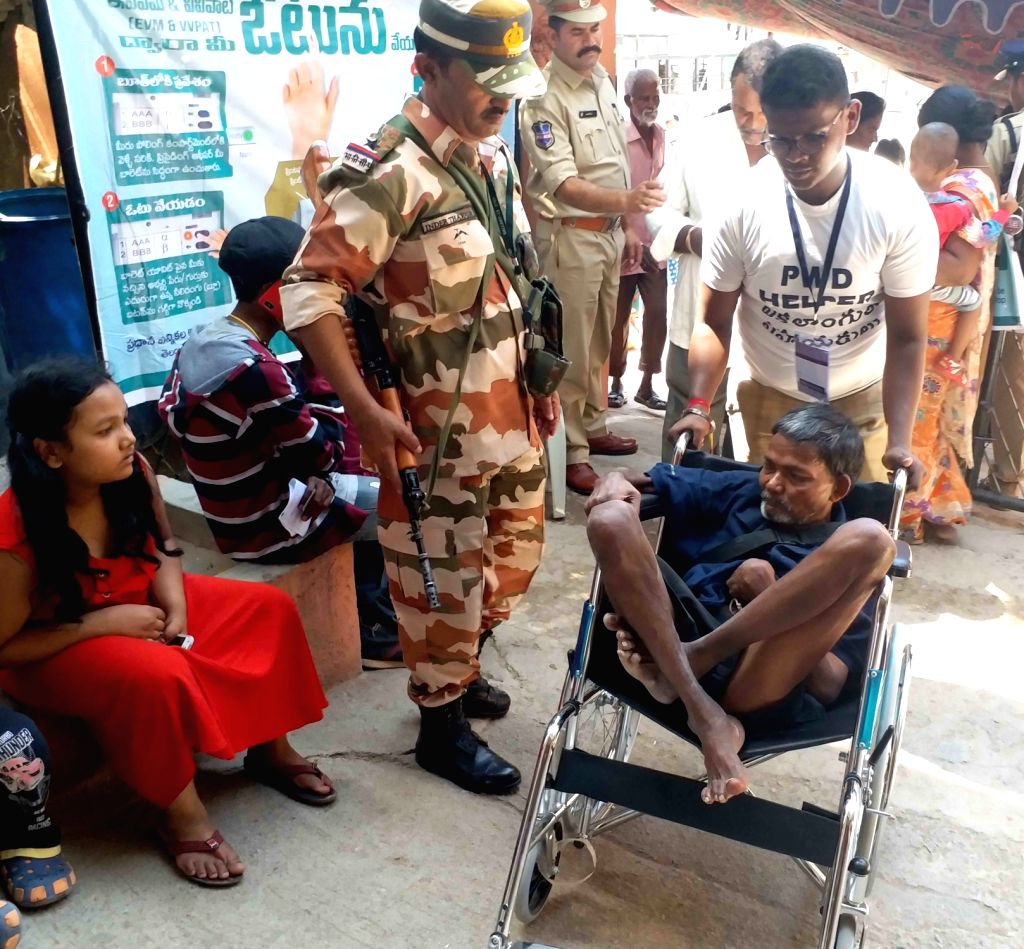 A physically challenged man arrives to cast his vote during the 2019 Lok Sabha elections, at a polling booth in Hyderabad, on April 11, 2019. Polling was underway on Thursday for the 42 ...