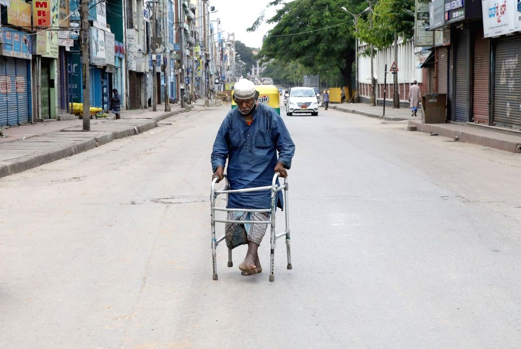 A physically challenged person moving at SP road during Coronavirus lockdown in the wake of the 2nd wave of COVID-19, in Bengaluru on Saturday, May 22, 2021.