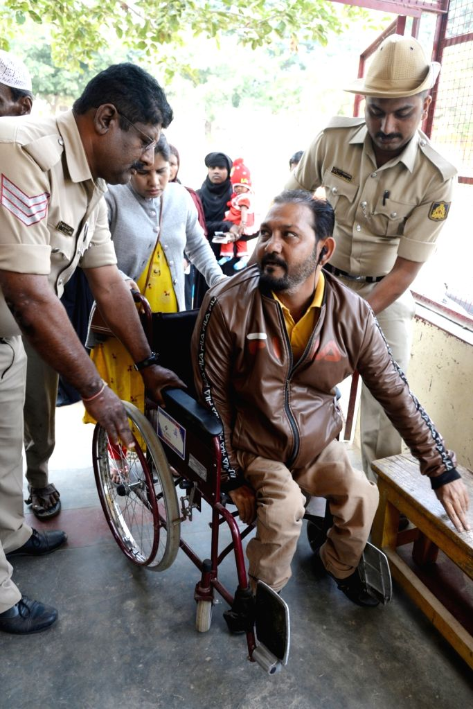 A physically challenged person on way to cast his vote at Yeshwantha Pura constituency for the Karnataka Assembly Bye election, in Bengaluru on Dec. 5,  2019.