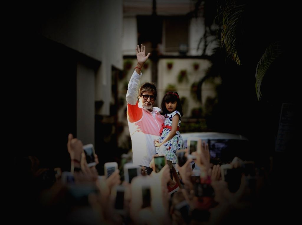 A picture shared by actor Amitabh Bachchan on twitter where he is seen waving at his fans along with his grand daughter Aaradhya Bachchan, in Mumbai on May 28, 2017. - Amitabh Bachchan and Aaradhya Bachchan