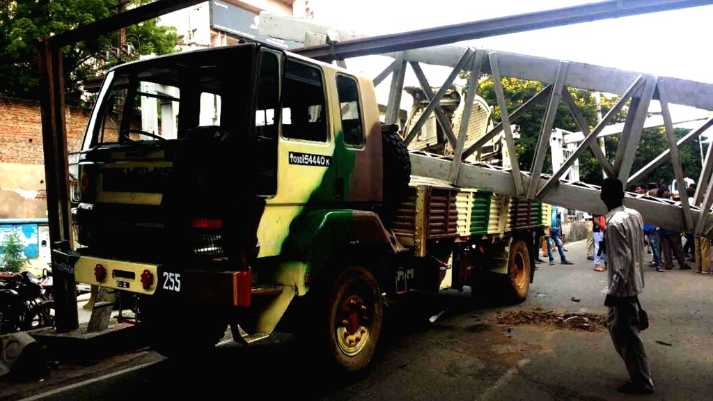 A pillar falls on a military truck at the Oliphant railway bridge in Secunderabad, Hyderabad on Sept 19, 2017.