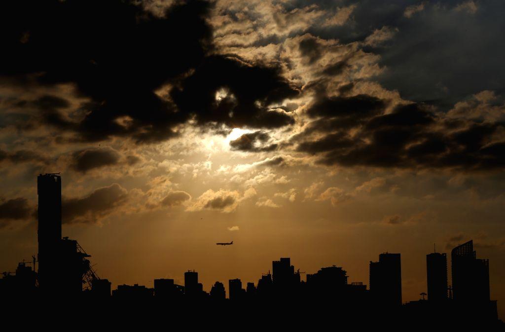 A plane flies over Beirut, Lebanon at sunset, Sept. 13, 2020.