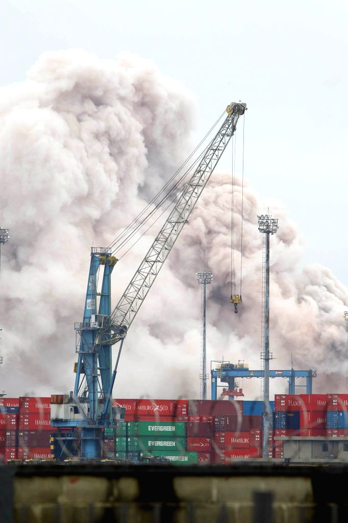 "A plume of smoke rises from the freight yard of the terminal of the carrier ""Localfrio"", in the city of Guaruja, Sao Paulo state, Brazil, on Jan. 14, ..."