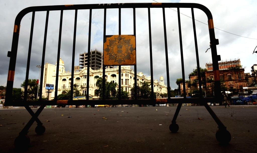 A police barricade placed at a Kolkata road to prevent movement of vehicular traffic during the biweekly COVID-19 lockdown, on Sep 11, 2020.