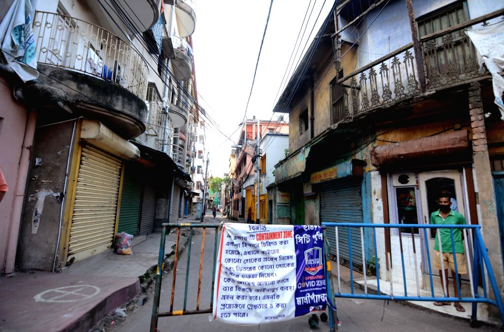 A police barricade put up outside a locality in Howrah after declared as a  Containment Zone and sealed with immediate effect during nationwide lockdown 5 imposed in the wake of COVID 19 ...