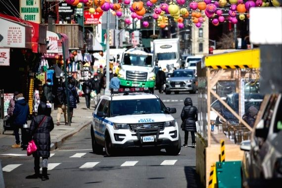 A police car is seen patrolling in Chinatown of New York, the United States, March 19, 2021.