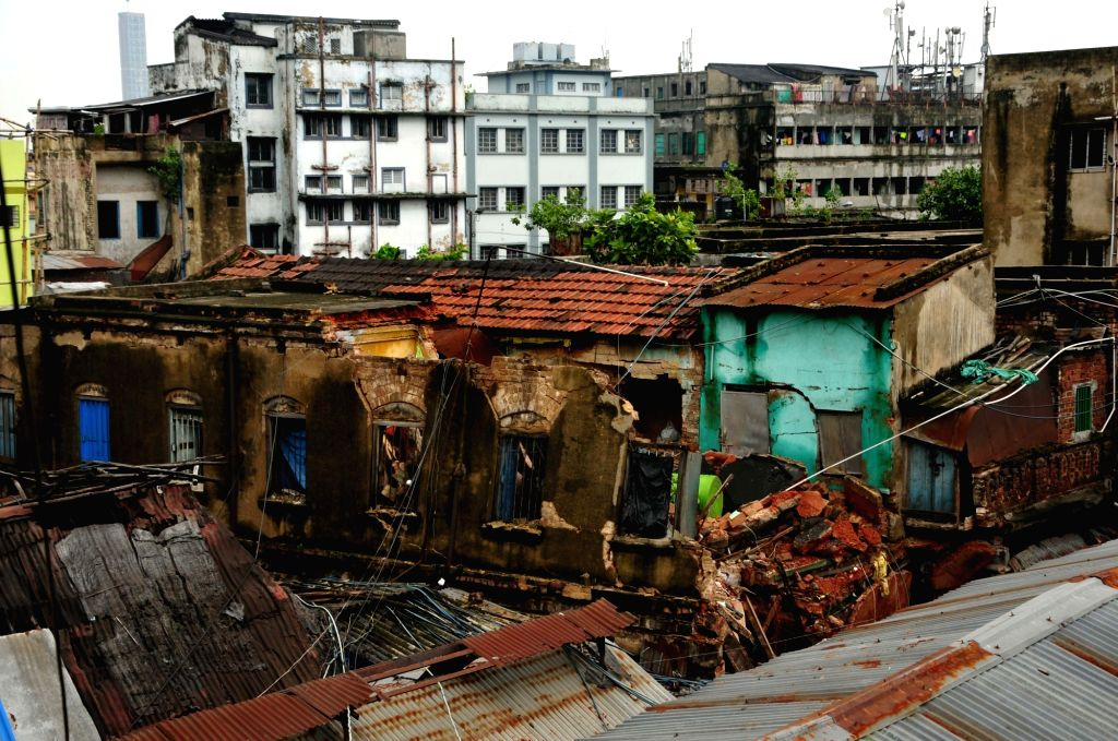 A police personnel during rescue operations at the site where an old two-storey residential building near Sealdah's Baithakkhana Bazar area collapsed following heavy rains, in Kolkata on ...