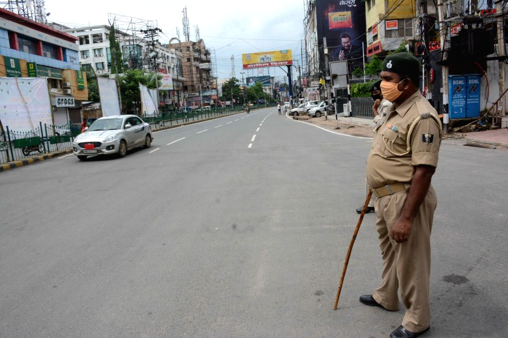A police personnel keeps a vigil during a complete COVID-19 lockdown re-imposed in Patna, on July 11, 2020.