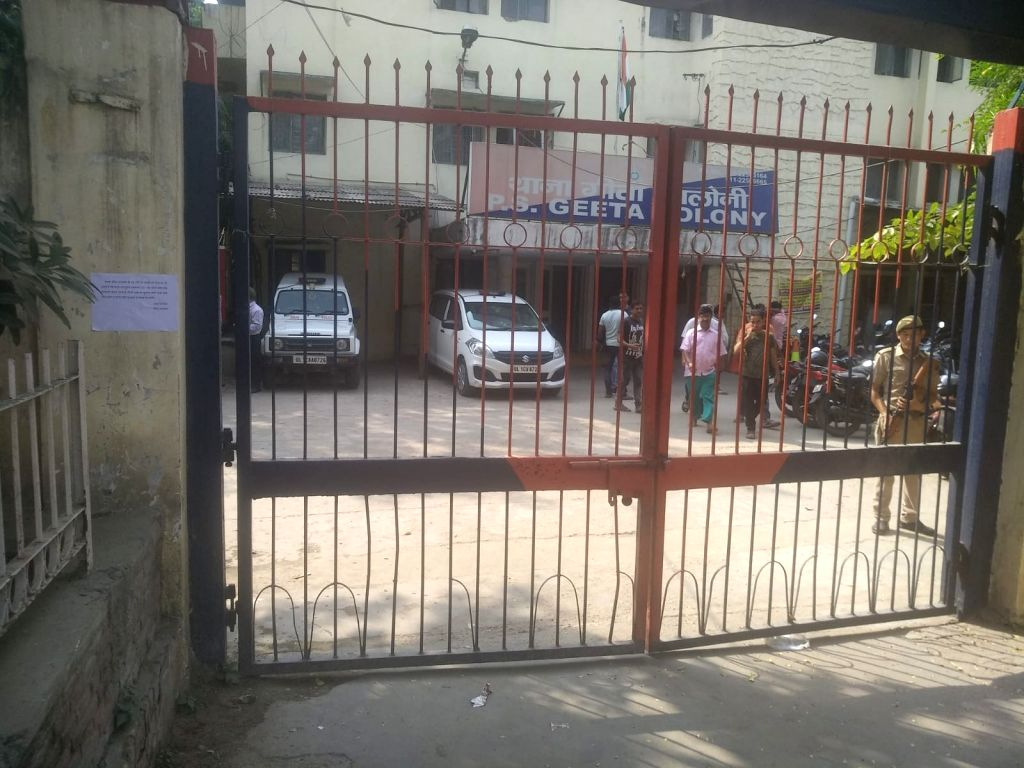 A police personnel stands guard at the Geeta Colony police station as security has been beefed up across police stations and colonies in the national capital following terror threats, in ...