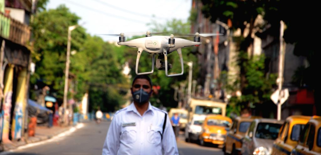 A police personnel uses a drone for surveillance in Kolkata during the extended nationwide lockdown imposed to mitigate the spread of coronavirus, on May 7, 2020.
